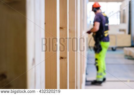 Contractor Carpenter Worker In Construction Zone. Worker And Wooden Constructions. Wooden Skeleton F