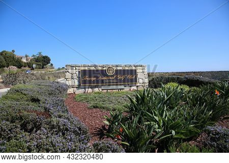 RANCHO PALOS VERDES CA, USA - August 28 2021: Donald Trump National Golf Club Sign. The Entrance to President Donald J. Trump's Rancho Palos Verdes Golf Course in California.