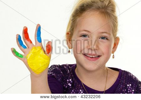 a small child with finger paints colors. funny and creative.