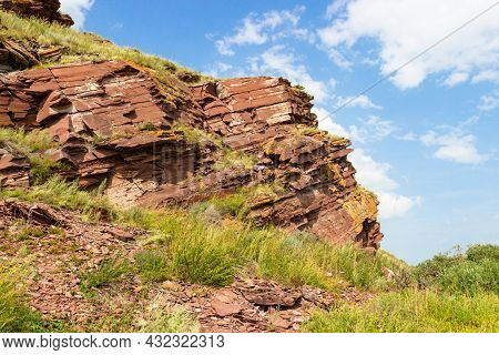 Layered Rock Formations Of Red Devonian Sandstone By The Sunduki Mountain Range In The Republic Of K