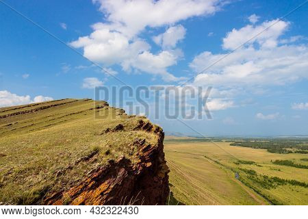 Perfect Landscape From The Edge Of The Cliff Of The Sunduki Mountain Range On The Summer Green Stepp