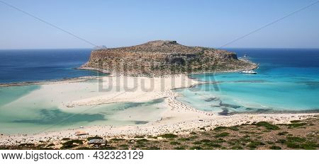 Balos Lagoon With Turquoise Clear Water With Beautiful White Sand Beaches And Gramvousa Island On Cr
