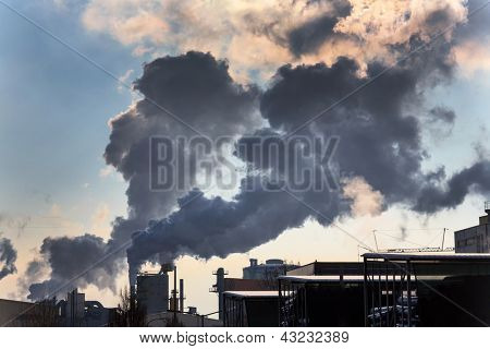 chimney of an industrial company with smoke. symbolic photo for environmental protection and ozone. poster