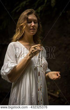Caucasian Woman Keeping Count During Pray And Meditation. Hand In Gyan Mudra. Buddhist Japa Mala. St