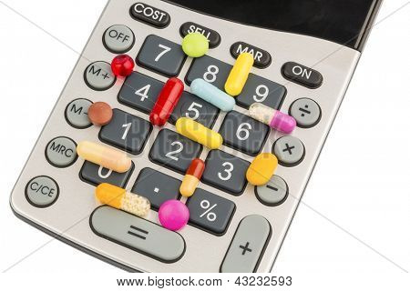 tablets are on a calculator. symbol photo for costs in the medical and pharmaceutical industry