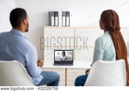 Black Married Couple Having Online Session With Psychologist, Using Laptop To Communicate To Marital