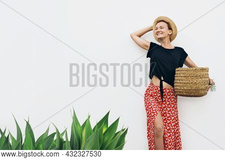 Rustic Look Beautiful Woman Holding Basket Against White Wall With Green Plants. Eco-friendly Local