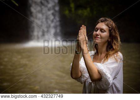 Caucasian Woman Holding Mala For Pray And Meditation. Buddhist Japa Mala. Hands In Namaste Mudra. Re