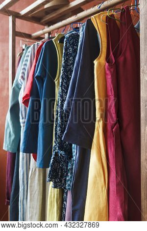 Fashion Clothes Hang On A Hanger. Clothes Hanging On A Rack