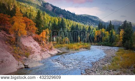 Scenic Crystal river landscape in Colorado rocky mountains surrounded with fall foliage
