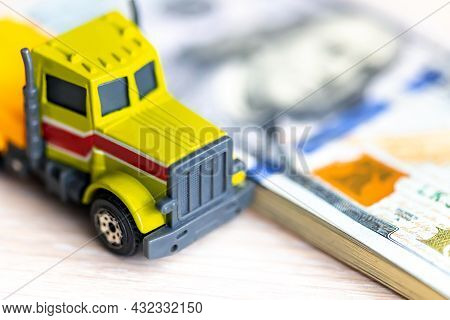 The Truck On Dollar Bills. Concept Of An Insurance Contract For New Trucks Or Expensive Fuel