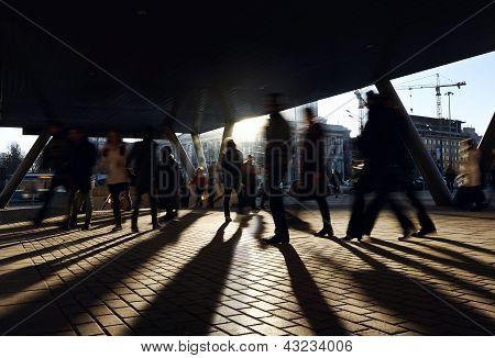 People walking near the metro station.