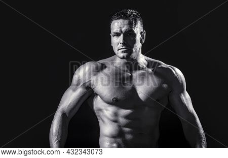 Strong Athletic Man Showing Muscular Body And Sixpack Abs. Showing Muscular Torso. Black And White