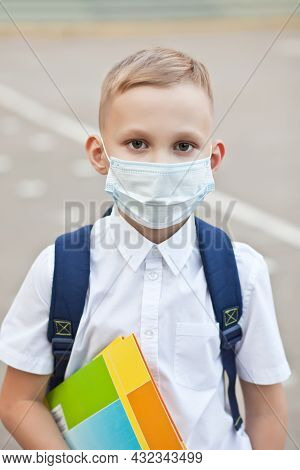Concept Of Coronavirus Covid-19. Schoolboy Wearing Medical Face Mask To Health Protection From Influ