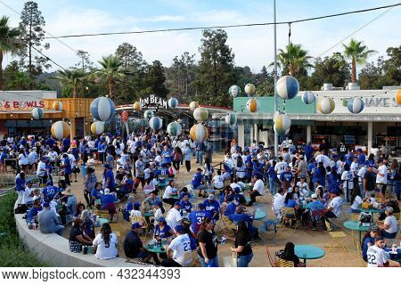 LOS ANGELES, CALIFORNIA, 29 JUNE 2021: Fans gather in the Outfield Plaza of Dodger Stadium.