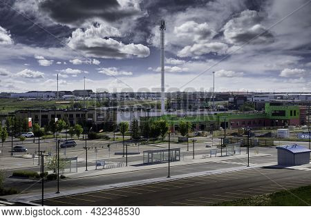 Airdrie Alberta Canada, August 31 2021: A Cell Phone Tower Stands Tall Next To A Public Transit Tran