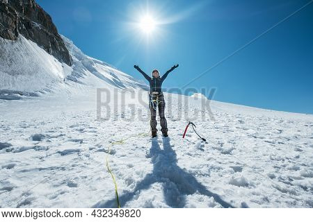 The Woman Raised Her Arms And Cheerfully Smiling While Ascending Mont Blanc (monte Bianco) Summit Dr