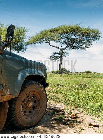 Tarangire National Park, Tanzania's Manyara Region. Safari Off-road Large Vehicle Dirty Front Wheel