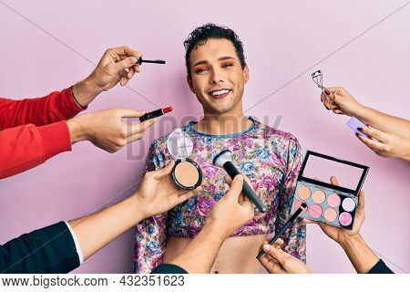 Handsome man wearing make up with make up cosmetics around with a happy and cool smile on face. lucky person.