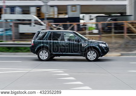 Land Rover Freelander 2 Hse Td4 Driving On A City Road. Compliance With Speed Limits On Road Concept