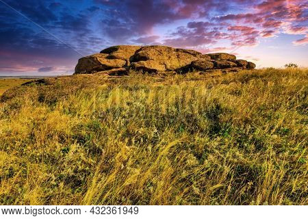 Evening landscape with stone in steppe
