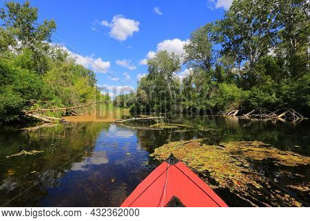 red kayak fload in wild river water surface