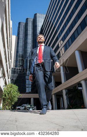 Portrait Of Businessman Walk Near Office. Business Man Walking. Business Success, Step, Boost Person
