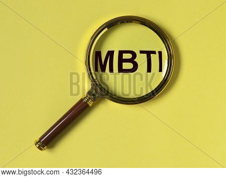 Mbti Test Of Personality Types. Acronym Through Magnifying Lens On Yellow Background. Psychology Con