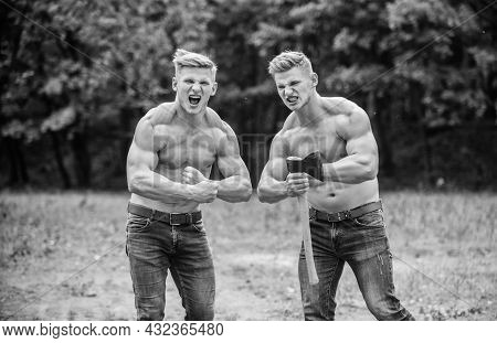 Handsome Brothers. Athletic Twins Use Ax. Men With Muscular Torso. Genetics Concept. Brotherhood Fri