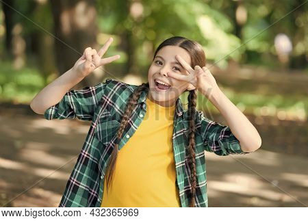 Keeping Cool. Cool Girl Show Peace Signs Natural Landscape. Summer Vacation. Casual Fashion Style. B