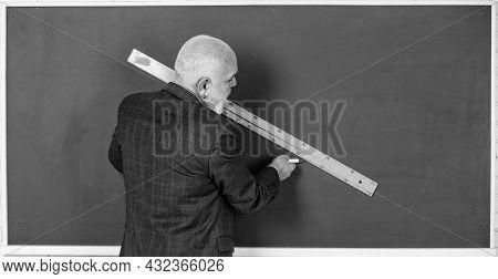 Draw Line. Bearded Tutor Man Draw With Ruler On Blackboard. Back To School. School Disciplines. Educ