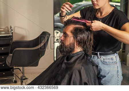 Mature Hipster With Beard At Hairdresser. Brutal Caucasian Hipster With Moustache Making New Hairsty