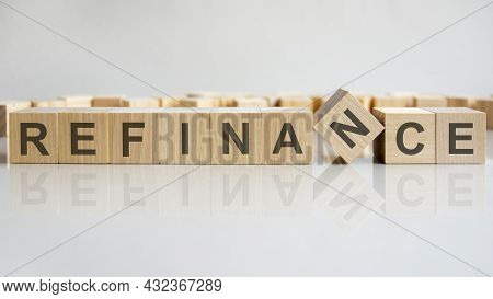 Word Refinance On Wooden Cubes, Gray Background