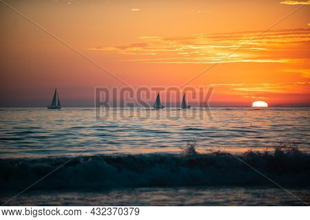 Sailboat At Sea. Panoramic View Of Sunset Over Ocean. Beautiful Serene Scene. Sea Sky Concept, Sunri