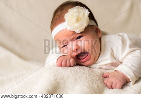 Childhood, Motherhood, Emotions, Fashion Concept - Worried Sad Crying Chubby Baby With Open Mouth Cl