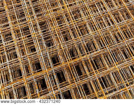 Thin Rusty Steel Welded Wire Mesh For Concrete Reinforcing. Industrial Material Corrosion Full Frame