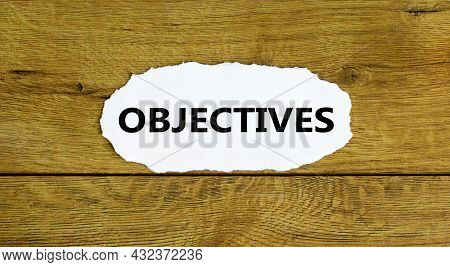 Objectives Symbol. The Concept Word 'objectives' On White Paper. Beautiful Wooden Background. Busine