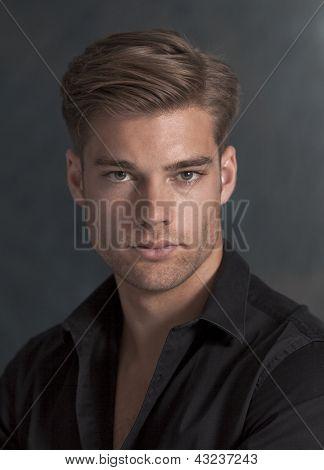 Studio portrait of handsome young man