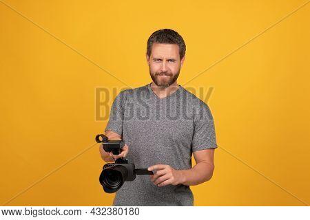 Smiling Cameraman Vlogging With Film Set. Unshaven Man With Camcorder. Videographer Making Video