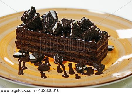 Layer Chocolate Cake With Devil's Sponge And Biscuit Chips