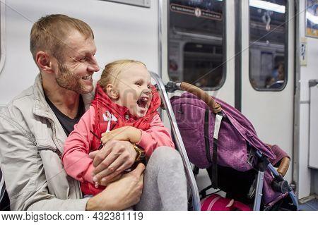 Mature Man And Little Emotional Girl Subway Passengers.
