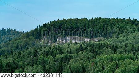 Wooded Hilly Landscape With With Limestone Rock