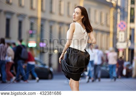 Female 18 Years On Crowded Street In Evening.