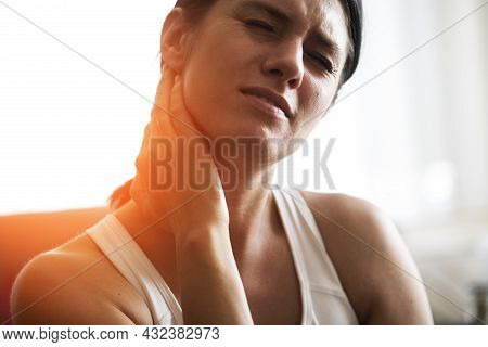 Tired Woman Massaging Rubbing Stiff Sore Neck Tensed Muscles Fatigued From Computer Work In Incorrec