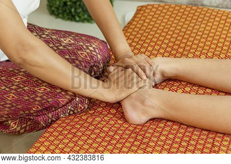 Healthcare Spa And Massage Thai Concept. Close Up Hands Of Thai Masseuse Woman Getting Massage Leg F