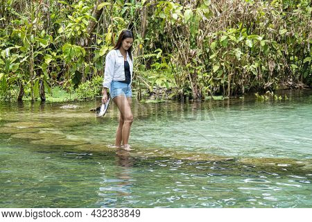 Adventure Summertime Lifestyle Leisure Holiday Concept. Traveler Young Woman Walking On Rock Blue Po