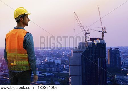 Construction Architecture Concept. Engineer Handsome Young Man Wear Yellow Security Hardhat Standing