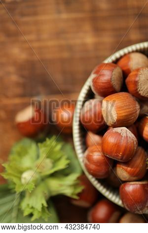 Hazelnut .nuts Abundance.nuts On The Table.nut Harvest. Ripe Nuts Plate And Green Nuts With Leaves O