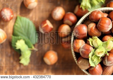 Hazelnut Close-up.nuts Abundance.nuts On The Table.nut Harvest. Ripe Nuts Plate And Green Nuts With