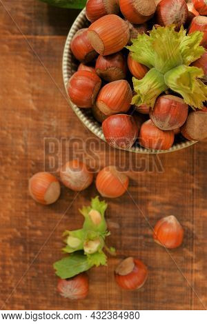 Hazelnut Close-up.nuts Abundance.nuts On The Table. Ripe Nuts Plate And Green Nuts With Leaves On Wo